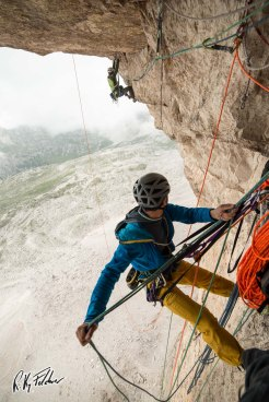 "Trying the crux pitch of ""Pan Aroma"", Tre Cime - Credits: Riky Felderer"